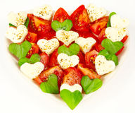 Heart made of tomatoes Stock Images