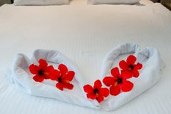 Heart made from towels on honeymoon bed Royalty Free Stock Photography