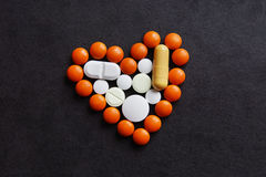 Heart made of various pills and tablets Stock Photo