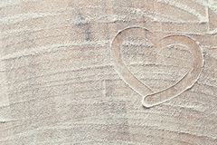Heart made from white flour Stock Photography
