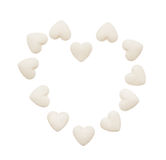 Heart made of white heart shape tablets isolated on white Royalty Free Stock Images