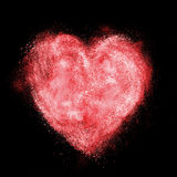 Heart made of white powder explosion isolated Royalty Free Stock Image