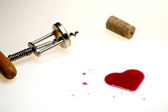 Heart made of wine. With old corkscrew and cork Stock Photography