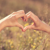 Heart made with woman fingers. Love concept stock image