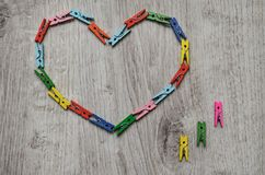Heart made of wooden clothespins royalty free stock photography