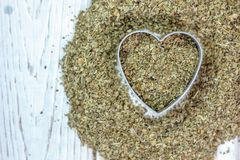 Heart made from yerba mate - dry leaves ready to cook mate tea. stock images