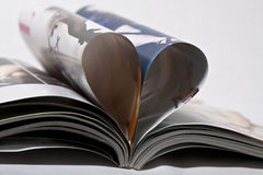 Heart of magazine pages. Isolated Stock Photos