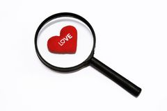 Heart in magnifying glass Royalty Free Stock Photos