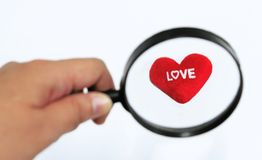 Heart in magnifying glass. On white background Royalty Free Stock Photos