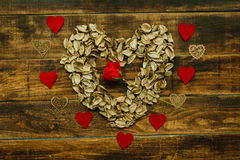Heart maked with dry petals Stock Photos