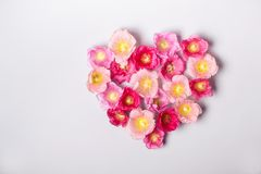 Heart of mallow flowers. Minimalism beauty, mothers Day or Valentines Day concept.  Royalty Free Stock Photography