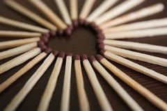 Heart of matches. Closeup on an brown background Royalty Free Stock Photos
