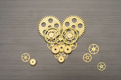 Heart mechanism. Heart made out of gears and cogs stock photos