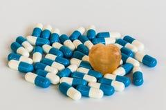 Heart and medication Royalty Free Stock Photo