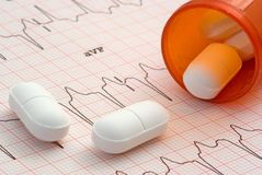 Heart Medication. A close up of a EKG with a bottle of pills sitting on it Royalty Free Stock Photo