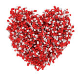 Heart medicine. Big heart made from red and white capsules Royalty Free Stock Photo