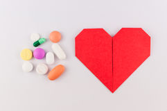 Heart with medicine on isolate background Royalty Free Stock Image