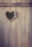 Heart Menu Board. Heart shape menu board hanging on wooden panel wall - vintage tone effect added to wood Royalty Free Stock Image