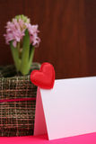 Heart message card soft focus. Heart message soft focus with light pink hyacinth at background Royalty Free Stock Images