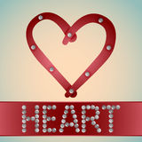 Heart with metal bolts. And letters Stock Photo