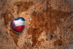 Heart with mississippi state flag  on a vintage world map crack paper background Stock Photography