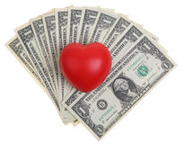 Heart and money. Red heart symbol over a one dollar bills with clipping path Stock Image