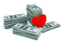 Heart with money Royalty Free Stock Photography