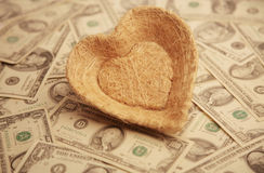 Heart with money background Stock Image