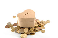 Heart money box. Over coins on white background stock image