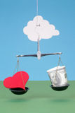 Heart and money on scales. Against the sky Royalty Free Stock Photos