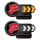 Heart monitor on gold and silver arrow nameplates Stock Photo
