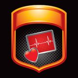 Heart monitor icon in orange display Royalty Free Stock Image