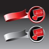Heart monitor on red and gray ribbons Royalty Free Stock Photos
