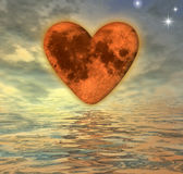 Heart-moon at sunset. Heart with texture mapping of the moon Royalty Free Stock Photo