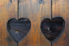 Heart motif. In a brown aged wooden house gate stock image