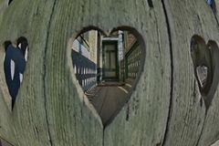 Heart motive interesting perspectives. Heart motive porch interesting perspectives with a door on the center royalty free stock photos
