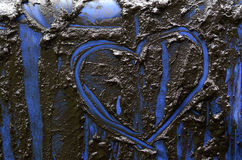 Heart on mud texture Stock Photography
