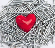 Heart and nails Royalty Free Stock Photos