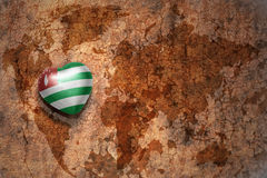 Heart with national flag of abkhazia on a vintage world map crack paper background. Stock Photos