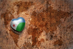 Heart with national flag of djibouti on a vintage world map crack paper background. Concept Royalty Free Stock Photography