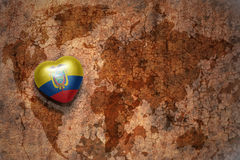 Heart with national flag of ecuador on a vintage world map crack paper background. Stock Photo