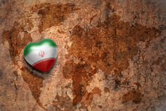 Heart with national flag of iran on a vintage world map crack paper background. Concept Royalty Free Stock Photography