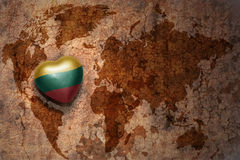 Heart with national flag of lithuania on a vintage world map crack paper background. Concept Royalty Free Stock Photo