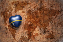 Heart with national flag of Nauru on a vintage world map crack paper background. Concept Royalty Free Stock Photo