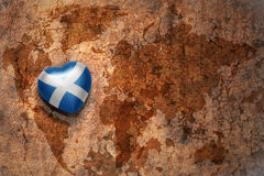 Heart with national flag of scotland on a vintage world map crack paper background. Concept Royalty Free Stock Photos