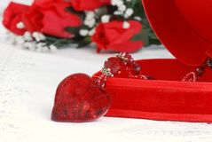 Heart necklace and jewelry box Stock Photos