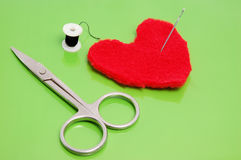 Heart and needle. Fashioned heart from textile materia by scissors Royalty Free Stock Image