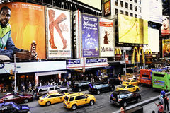 In the heart of New york. NEW YORK CITY -JULY 09: Times Square, featured with Broadway Theaters and animated LED signs, is a symbol of New York City and the royalty free stock images