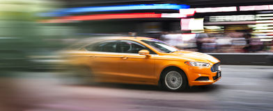 In the heart of New-York. Speedy taxi in Times square New York city, USA stock image