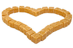 Heart from not refined reed sugar .Close up on a white background Royalty Free Stock Photo